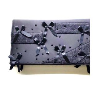 Black clutch with bows and lace